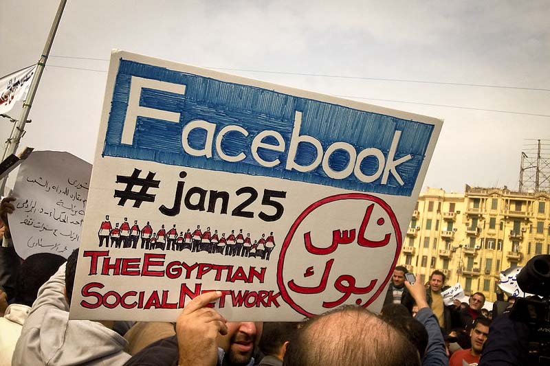 Egyptian protesters in Tahrir Square in 2011 celebrate Facebook's contribution to the Arab Spring. (Photo by Essam Sharaf via Flickr)