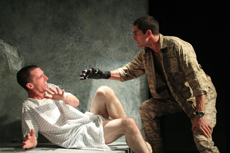 Kev (Ryan Higgins) reunited with fellow U.S. Marine Tom (Jonathan Crimeni) and his new robotic hand. (Photo courtesy Washington Ensemble Theatre)