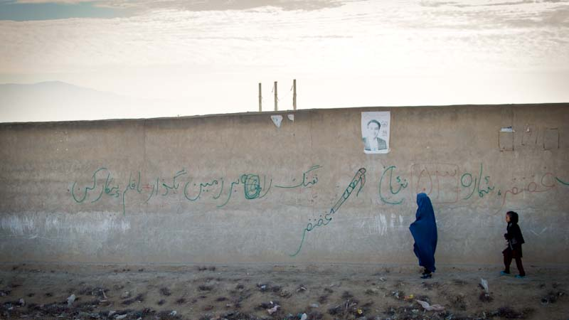 """""""Lay down your arms; fight with the pen"""" in northern Afghanistan. (Photo by Dean Chahim)"""
