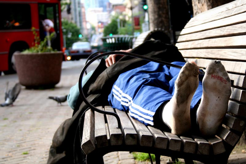 A homeless man sleeps in Pioneer Square. A count last January tallied 2736 people sleeping outside in King County without shelter. (Photo by C4Chaos via Flickr)