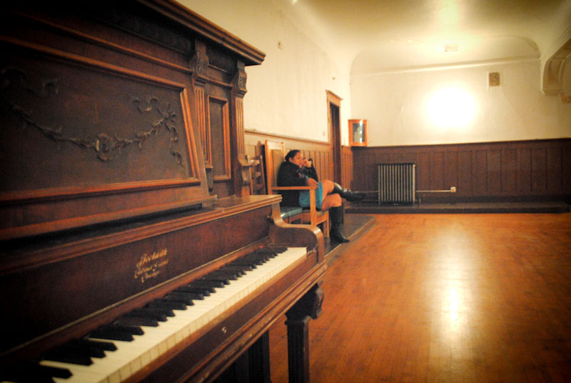 Caretaker Lulu Carpenter in the Lodge Room at Washington Hall. (Photo by Anna Goren)