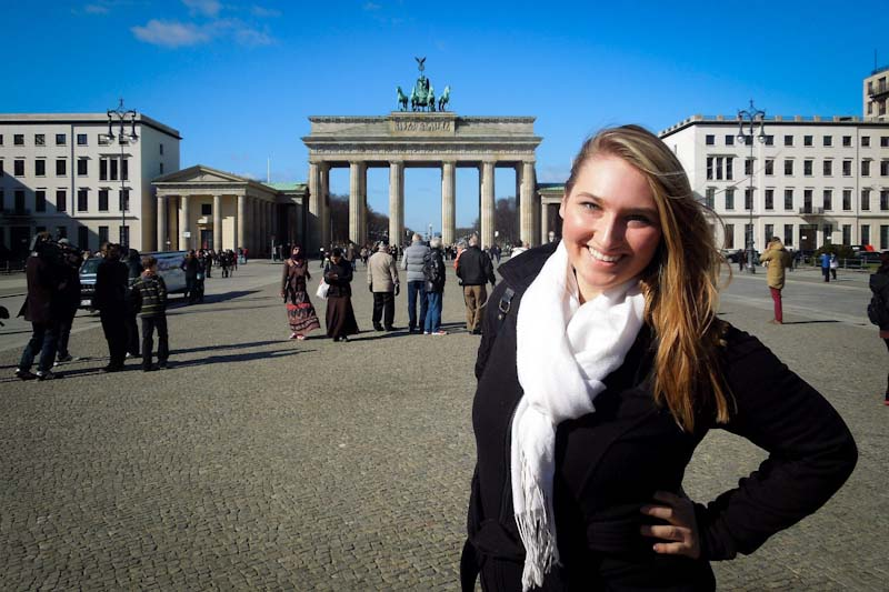A study abroad student at Berlin's Brandenburg Gate. (Photo by KatieJean97 via Flickr)