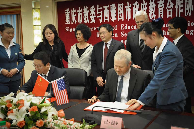 Mayor McGinn signing a memorandum of understanding with counterpart in Seattle sister city Chongqing, China. (Photo courtesy McGinn Campaign)