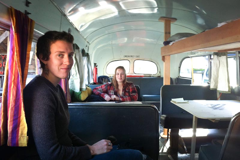"""Preschool teacher, Claire Tuchel (left) and Evergreen College student, Sierra Brown, on to the """"Cascadia Freedom Caravan,"""" bus headed to Arizona for a """"Tear Down The Walls"""" gathering of activists this weekend. (Photo by Sarah Stuteville)"""