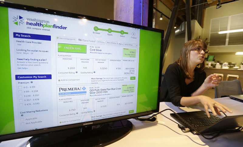 Nelly Kinsella shows off the website of the Washington health insurance exchange before it's launch on October 1st. (Photo by Elaine Thompson/Associated Press)
