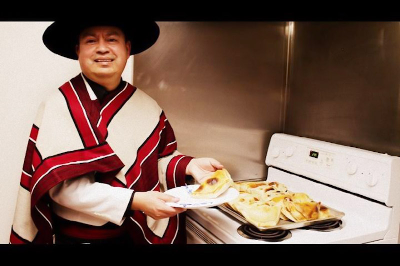 Chef Aurelio Pino presents his famous empanadas wearing traditional Chilean garb. (Photo courtesy Aurelio Pino)