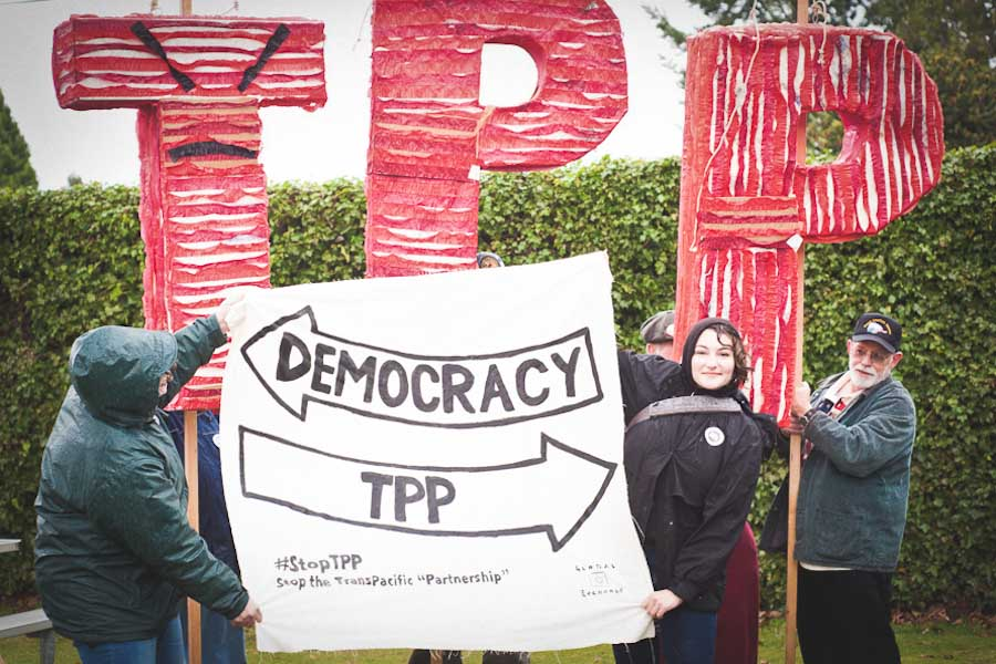 People gather at Peace Arch Park on the Canadian border in December 2012 to oppose the U.S.-led Trans Pacific Partnership. (Photo by Caelie Frampton)