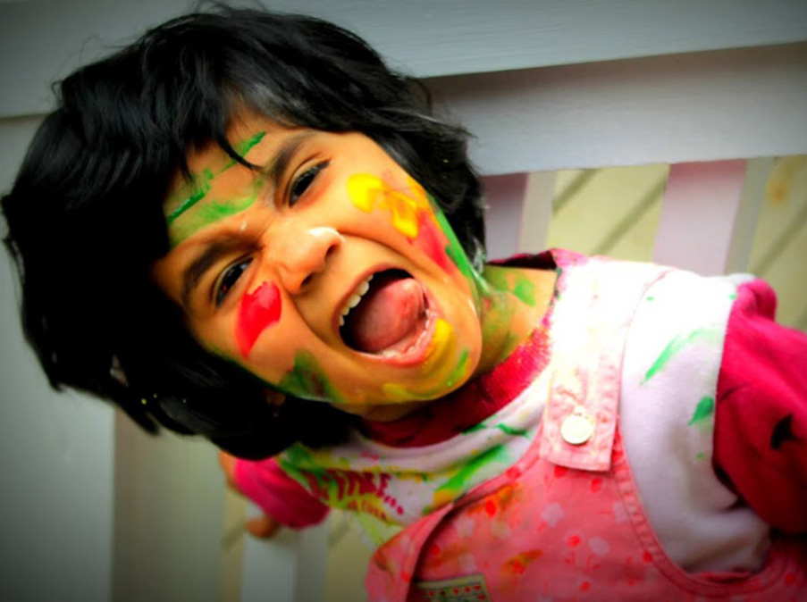 The author's daughter, Ditti, showing off her colors for Holi last year. (Photo by Padmaja Ganeshan-Singh)