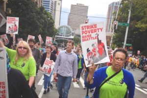 Fourteen year Wal-Mart employee Mary Watkins (right) marches in support of a $15 minimum wage in Seattle. (Photo by Reagan Jackson)