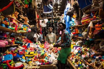 Kevin Abraham, Haji Mutonye, Ismael Akuku of the The Neibaz Fashion House shop at the Toi Market. (Photos by Kelly Ranck)