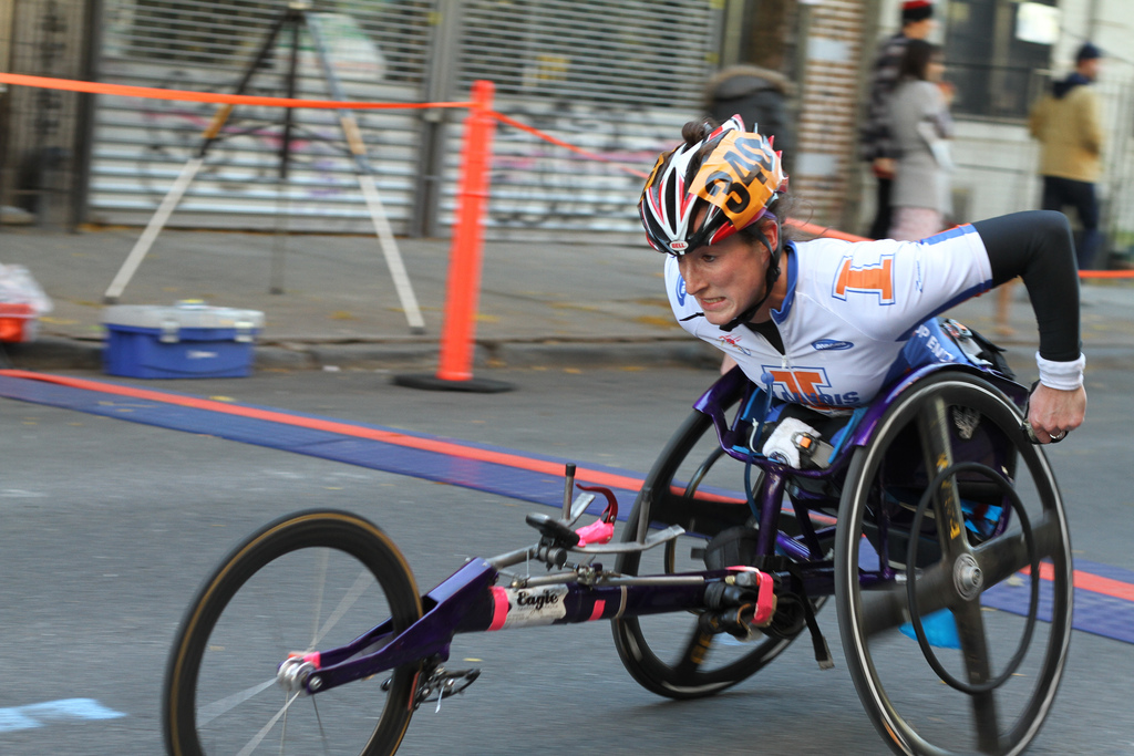 A New York City Marathon competitor uses a racing wheelchair. (Photo by Howard N2GOT via Wikipedia)