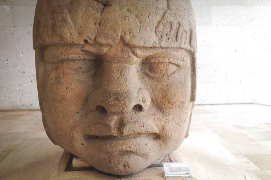 Olmec heads on display at the Anthropology Museum in Veracruz are often referenced as evidence of a pre-Columbian connection between Africa and Mexico because of their African features, but most anthropologists dismiss the connection. (Photo by Reagan Jackson)