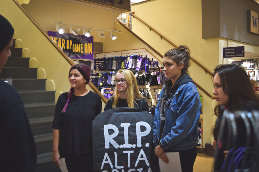 Sophia Lewis, Sara Parolin, Amalia de la Iglesia, Shannon Long, all members of UW United Students Against Sweatshop, at a protest action pressuring the University Bookstore to more prominently display Alta Gracia apparel. (Photo by Daria Kroupoderova)