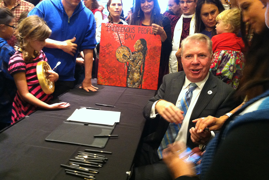 Mayor Ed Murray shakes hands with tribal leaders shortly after signing Seattle's Indigenous People's Day Resolution. (Photo by Christina Twu)