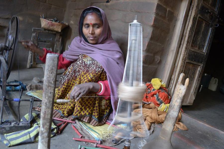 Eco Kargha weaver Poonam Devi prepares bobbins of silk thread, January 2013.