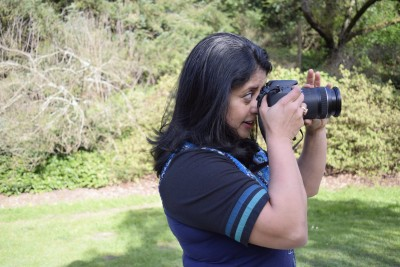 Sudeshna Sen takes photos in the Arboretum in Seattle, Wash. while doing site location research for an upcoming video project involving her son's school. (Photo by Rayna Stackhouse)