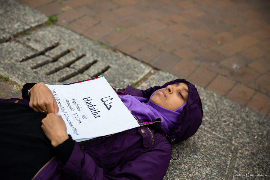 Fethya Ibrahim, a junior at UW, participates in a die-in on Red Square representing the depopulated Palestinian village Hadatha. Ibrahim was among fifty-some individuals who protested an Israeli celebration of the 1948 Palestinian exodus. (Photo by Aditya Ganapathiraju)