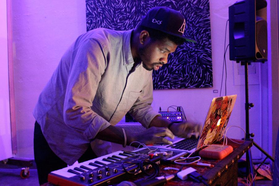 """Space Gospel"" artist NorvisJr performs at Moshka. (Photo by Joy Okot-Okidi)"