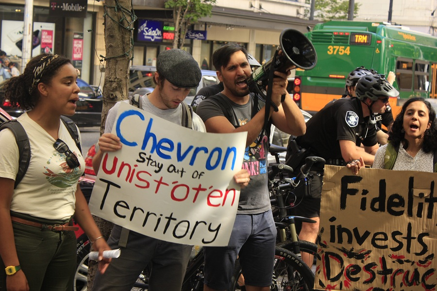 Activists protest against Fidelity Investments, fourth largest Chevron investor outside the office building in Downtown Seattle(Photo by Goorish Wibneh)