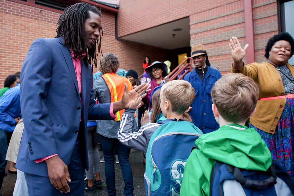 Teddy McGlynn-Wright (left) showed up dressed to the nines to greet students. (Photo by Jovelle Tamayo)