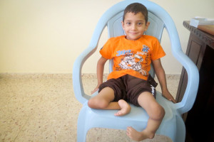 Weseem Shoulub, 7, resting in the Palestine Children's Relief Fund office in Gaza last year. Shoulub underwent surgery to amputate both legs at Spokane Shriners Hospital on October 7th. (Photo courtesy PCRF)