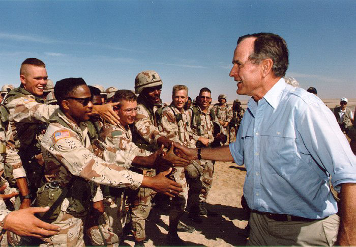 President George H. W. Bush visits American troops stationed in Saudi Arabia in 1990, in the lead up to the first Gulf War. (Photo from the Bush Library via Wikipedia)