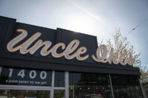 Uncle Ike's in the Central District has pushed laws that limit pot stores to one 1,600-square-inch sign by putting larger neon signs on its paraphernalia shop next door, and on a mural next to the shop. (Photo by Alex Stonehill)