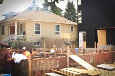 A building inspector from the city discusses with construction worker at Columbia City on Rainier Avenue South.(Photo by Goorish Wibneh)