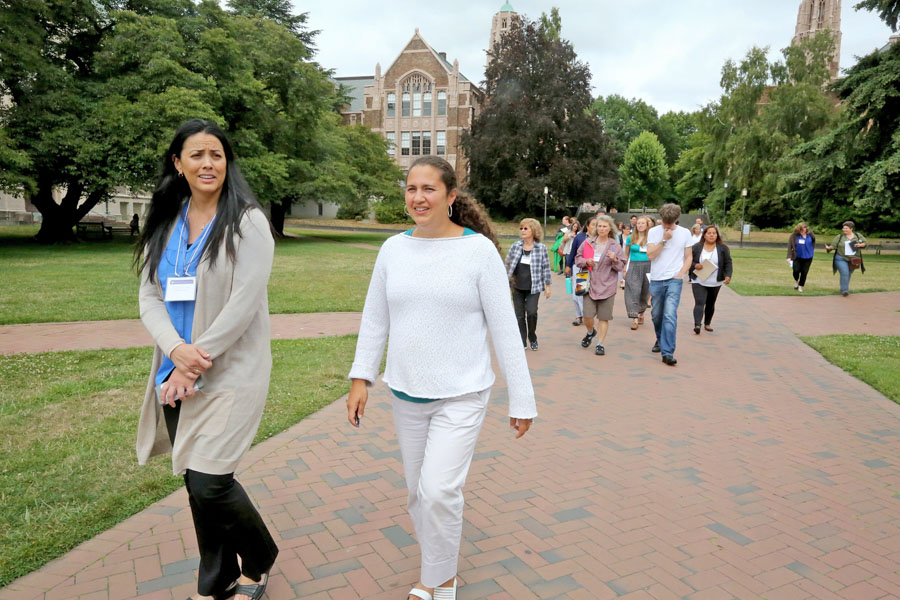 Native Education Certificate Program Co-Directors Elizabeth West, left, and Megan Bang, right, lead a group of their students across the Quad at University of Washington, which used to be a Duwamish Village. (Photo by Greg Gilbert / The Seattle Times)