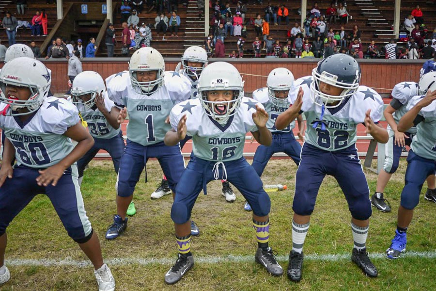 Beacon Hill Cowboy Junior Jarel Craig (center) and his teammates warm up before their game against the Renton Rangers. (Photo by Susan Fried)