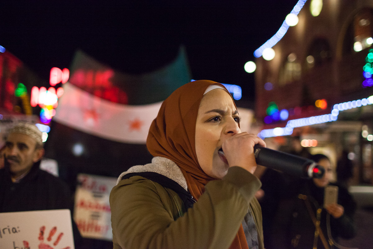 Isra Ayesh leads the March for Aleppo through Pike Market in downtown Seattle on Friday, December 16th. (Photo by Ramon Dompor)