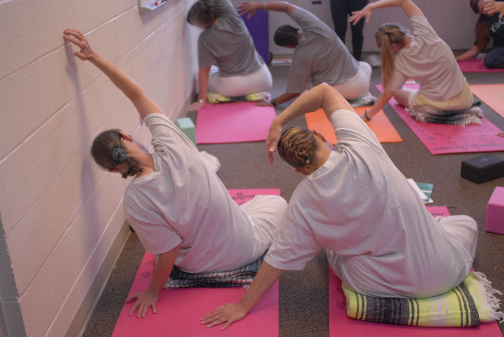 Inmates Of The Washington Corrections Center For Women Practice Yoga At A Yoga Behind Bars Teacher Training Photo By Emily Westlake The Seattle Globalist