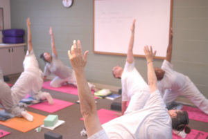 Inmates of the Washington Corrections Center for Women practice yoga at a Yoga Behind Bars teacher training. (Photo by Emily Westlake)