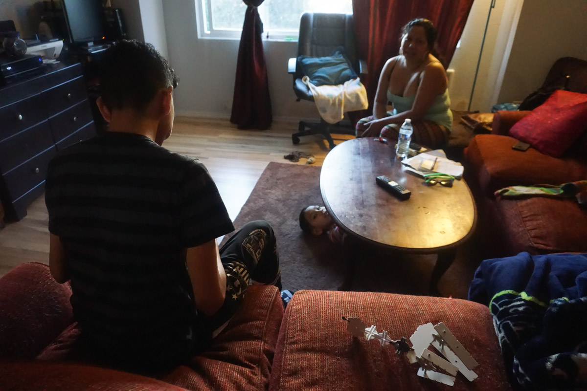 Ricardo Lopez and his mother Ana Daysi Guerra De Lopez in their Burien apartment. (Photo by Agatha Pacheco)