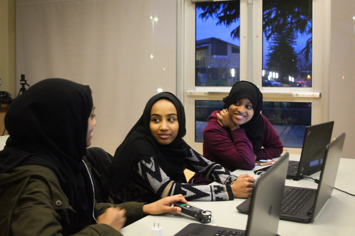 Jemila Abdullah, Iftin Kedir and Munera Mohammed (from left) during a coding class for East African youth held by Companion Athletics. (Photo by Goorish Wibneh)
