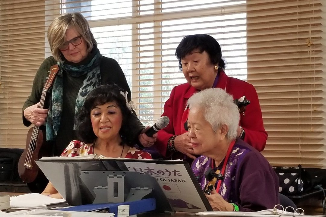 Members of Ukulele 101 rehearse for the group's upcoming Christmas party. Ukulele 101 is a class provided by Keiro Northwest, an organization dedicated to helping older residents of Asian descent. (Photo by Alex Visser)