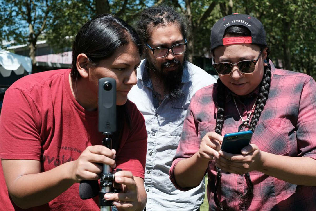 Participants in last year's 4th World Indigenous Media Lab work hands-on with a camera. (Photo Courtesy of Tracy Rector)