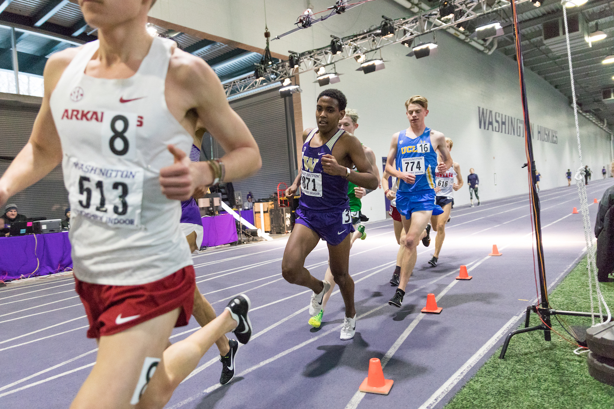 Tibebu Proctor, 19, runs in the 5,000 meters at the Husky Classic for Washington on Feb. 8, 2019. Proctor earned All-American honors for the first time in his career in cross country last season after finishing 38th at the national meet.